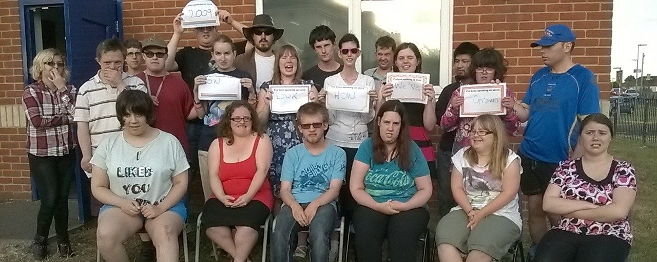 SAY | Group of people with signs | Adults with Learning Disability | Choices Advocacy